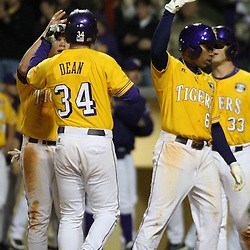 2009 February 20: LSU's Blake Dean is congratulated by teammates after hitting a homerun during a NCAA baseball match up between the #1 ranked LSU Tiger and the unranked Villanova Wilcats at the newly constructed Alex Box Stadium in Baton Rouge, Louisiana..