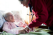 Nurse Ruth Collins checks on Bertha Milliard during a homecare visit in Fort Fairfield, Maine, Monday, November 24, 2009.  Craig Dilger for The New York Times