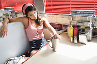 Young Woman Young Woman Relaxing in a Diner Booth?? in a Diner
