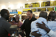 September 19, 2012- Queens, New York:  (L-R) Former Prisoner Amadou Scattred Janneh, Rev. Jesse Jackson, The Rainbow PUSH Coalition and Former Prisoner Tamsir Jasseh walk out of JFK Terminal 1 as free men after being held as prisoners in the Gambia, West Africa. Former Prisoner Amadou Scattred Janneh, a former Professor at the University of Tennessee, who held dual US Citizenship with the Gambia, was serving a life sentence for Treason. In addition to him, Tamsir Jessah, a U.S Citizen and former U.S. Military Veteran with dual citizenship with the West African nation was also serving a twenty-year sentence for Treason. With a face-to-face appeal by Rev. Jesse L. Jackson, with the Yayha Jammeh, President of The Gambia an agreement was made to release the two American citizens into Rev. Jackson's custody who allow them to return to the United States with Jackson Tuesday night.  The two men returned to the U.S. by plane with Rev. Jackson from The Gambia to joyfully grateful waiting family members. In addition, President Jammeh has agreed to extend the moritorium on executions indefinitely, marking a significant gain for Human Rights in the West African Nation on September 19, 2012. (Terrence Jennings)