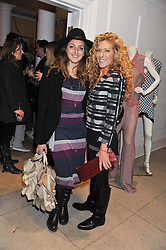 Left to right, NATASHA CORRETT and KELLY HOPPEN at a party to celebrate the switching on of the Christmas Lights at the Stella McCartney store, Bruton Street, London on 29th November 2011.
