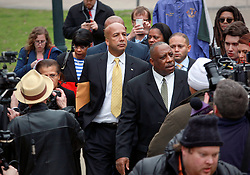12 February 2014. New Orleans, Louisiana. <br /> A grim faced Ray Nagin, former mayor of New Orleans leaves Federal court with his wife Seletha and lawyer Robert Jenkins in a media scrum. The former mayor was found guilty on 20 of 21 corruption charges, convicted on 1 count of conspiracy, 5 counts of bribery, 9 counts of wire fraud, 1 count of money laundering and 4 counts of filing a false tax return.<br /> Photo; Charlie Varley