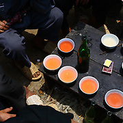 Corn alcohol goes around a table at the Sa Phin market in Ha Giang, Vietnam's northernmost province.