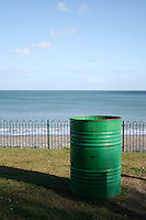 Green rubbish bin at Killiney beach in Dublin Ireland
