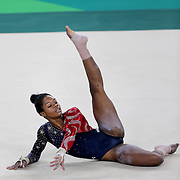 Gymnastics - Olympics: Day 2   Gabrielle Douglas #392 of the United States performing her Floor routine during the Artistic Gymnastics Women's Team Qualification round at the Rio Olympic Arena on August 7, 2016 in Rio de Janeiro, Brazil. (Photo by Tim Clayton/Corbis via Getty Images)