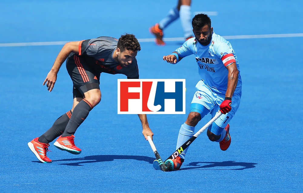 LONDON, ENGLAND - JUNE 20:  Manpreet Singh of India and Valentin Verga of the Netherlands battle for the ball during the Pool B match between India and the Netherlands on day six of the Hero Hockey World League Semi-Final at Lee Valley Hockey and Tennis Centre on June 20, 2017 in London, England.  (Photo by Alex Morton/Getty Images)