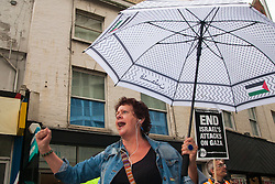 "London, July 5th 2014. Despite occasional drizzle, hundreds protest near the Israeli embassy in London against the ongoing occupation of Palestine and the west's support of ""Israel's collective punishment of Palestinians""."