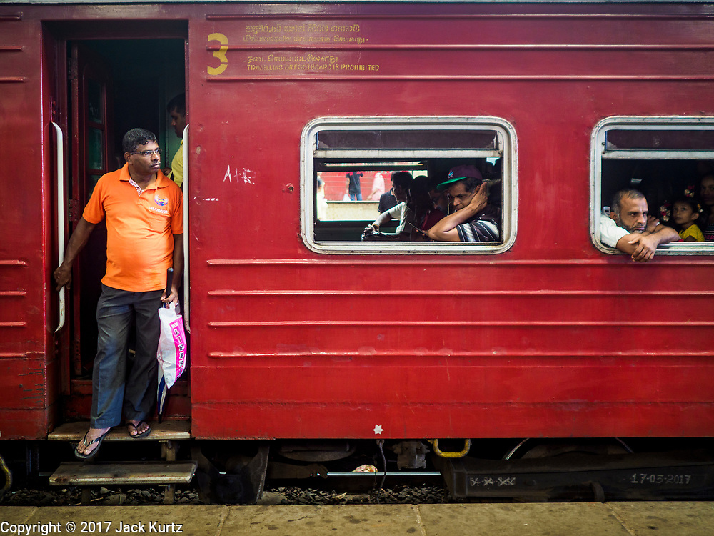 07 OCTOBER 2017 - COLOMBO, SRI LANKA: Passengers on an incoming train at the Fort Station in Colombo. The Fort Station is Colombo's main train station and serves as the hub of Sri Lanka's train system. The station opened in 1917 and is modeled after Manchester Victoria Station.    PHOTO BY JACK KURTZ