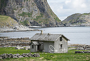 An old abandoned wooden house in the village of Måstad or Mostad, part of the Lofoten archipelago, Norway.