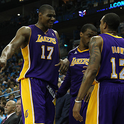 April 28, 2011; New Orleans, LA, USA; Los Angeles Lakers center Andrew Bynum (17) and point guard Shannon Brown (12) during the third quarter in game six of the first round of the 2011 NBA playoffs against the New Orleans Hornets at the New Orleans Arena. The Lakers defeated the Hornets 98-80 to advance to the second round of the playoffs.   Mandatory Credit: Derick E. Hingle