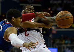 Los Angeles Clippers forward Tobias Harris (34) and Washington Wizards guard John Wall (2) battle for a loose ball during the third quarter at Capitol One Arena in Washington, DC.