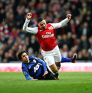 Picture by Andrew Tobin/Focus Images Ltd. 07710 761829. .21/01/12. Rafael (21) of Manchester United (L) tackles Alex Oxlade-Chamberlain (15) of Arsenal during the Barclays Premier League match between Arsenal and Manchester United at Emirates Stadium, London.
