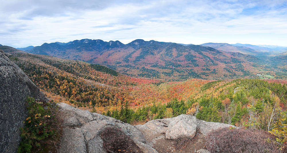 Adirondacks, NY.  It was a good place to take a break in the climb.  The summit was right above me, but I liked the foreground.  Across the Ausable Valley, the Great Range marched southward.  Autumn was showing off.