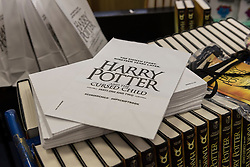 """© Licensed to London News Pictures. 31/07/2016. London, UK.  Piles of books on display in Waterstones bookshop in Harrow on the day that """"Harry Potter and the Cursed Child"""", the script, in book form, of the play by JK Rowling goes on sale. Photo credit : Stephen Chung/LNP"""