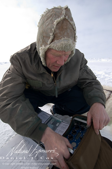 Dr Steven Amstrup prepares a radio telemetry device for tracking a polar bear on the Beaufort Sea, Alaska.