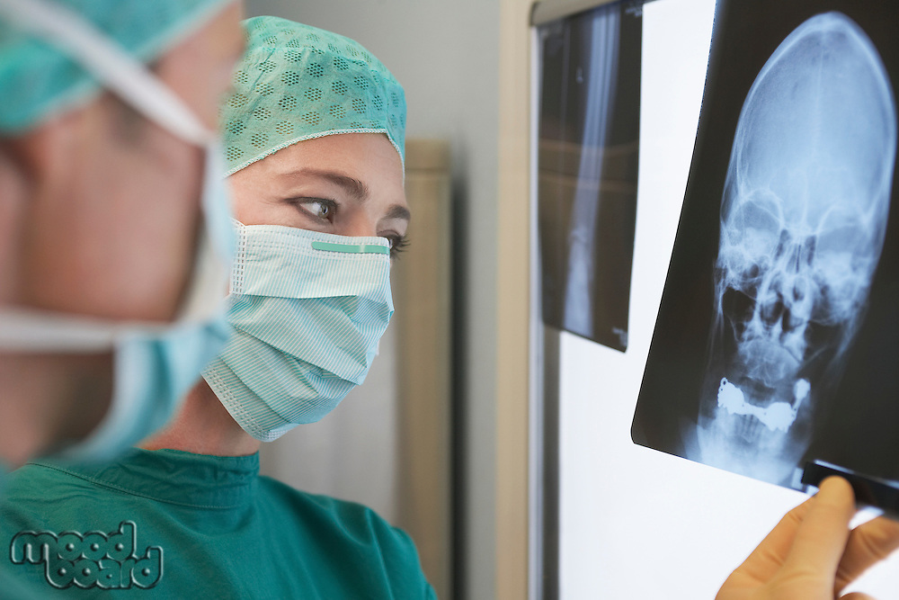 Radiologists Examining X-Ray of skull close up