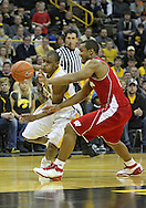 February 09 2011: Iowa Hawkeyes guard Bryce Cartwright (24) tries to get around Wisconsin Badgers guard Jordan Taylor (11) during the second half of an NCAA college basketball game at Carver-Hawkeye Arena in Iowa City, Iowa on February 9, 2011. Wisconsin defeated Iowa 62-59.