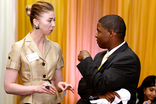 Carly P. Lindstrom of Horan (left) and Marcus Taylor of Anthem Blue Cross & Blue Shield during the Better Business Bureau's Eclipse Integrity Awards dinner at the Ponitz Center at Sinclair Community College in downtown Dayton, Tuesday, May 8, 2012.