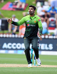 Pakistan's Shadab Khan reacts while bowling against New Zealand in the fifth one day International Cricket match, Basin Reserve, Wellington, New Zealand, Friday, January 19, 2018