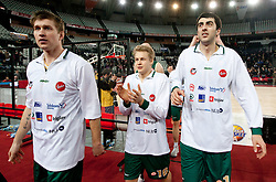 Vladimer Boisa (7) of Olimpija, Sasu Salin (10) of Olimpija and Giorgi Shermadini (16) of Olimpija after winning the Euroleague Top 16 basketball match between Lottomatica Virtus Roma (ITA) and KK Union Olimpija Ljubljana (SLO) in Group F, on January 20, 2011 in Arena PalaLottomatica, Rome, Italy. Olimpija defeated Lottomatica 64 - 63. (Photo By Vid Ponikvar / Sportida.com)
