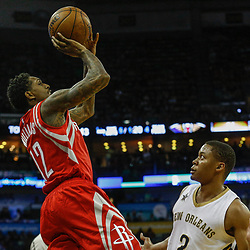 Mar 17, 2017; New Orleans, LA, USA; Houston Rockets guard Lou Williams (12) shoots over New Orleans Pelicans guard Tim Frazier (2) during the first quarter of a game at the Smoothie King Center. Mandatory Credit: Derick E. Hingle-USA TODAY Sports