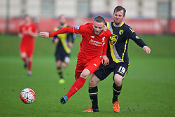 KIRKBY, ENGLAND - Tuesday, January 5, 2016: Liverpool's Ryan McLaughlin in action against Morecambe's Laurence Wilson during the Under-21 Friendly match at the Kirkby Academy. (Pic by David Rawcliffe/Propaganda)