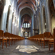 Inside St. Walltrude Cathedral, near the rear end of the grand church.