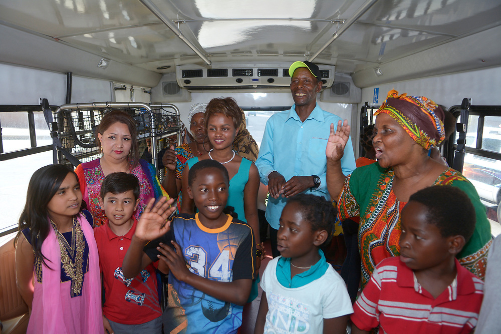 gbs032017l/ASEC -- Members of the  Immigrant and Refugee Village of Albuquerque check out a city transit van donated to the New Mexican Women's Global Pathways program which transports children and adults to English classes after a ceremony on Monday, March 20, 2017.The New Mexican Women's Global Pathways original van had broken down.(Greg Sorber/Albuquerque Journal)