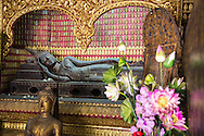 Recling Buddha Statue in the Reclining Buddha Shrine (Red Chapel) at Wat Xieng Thong (Golden City Temple), Luang Prabang, Laos.