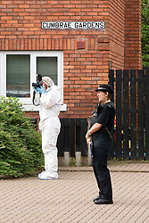 © Licensed to London News Pictures. 27/06/2012. Salford , UK . Forensic examiners at Cumbrae Gardens , Weaste, Salford, Greater Manchester where a woman was stabbed to death in a house yesterday (26th) evening . The murder is being described as a domestic incident and police have arrested a man . Photo credit : Joel Goodman/LNP