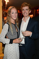 HECTOR & LUCY GUINNESS at an exhibition of the 50 best party pictures from Tatler from the past 50 years, held at Annabel's, Berkeley Square, London on 9th September 2013.