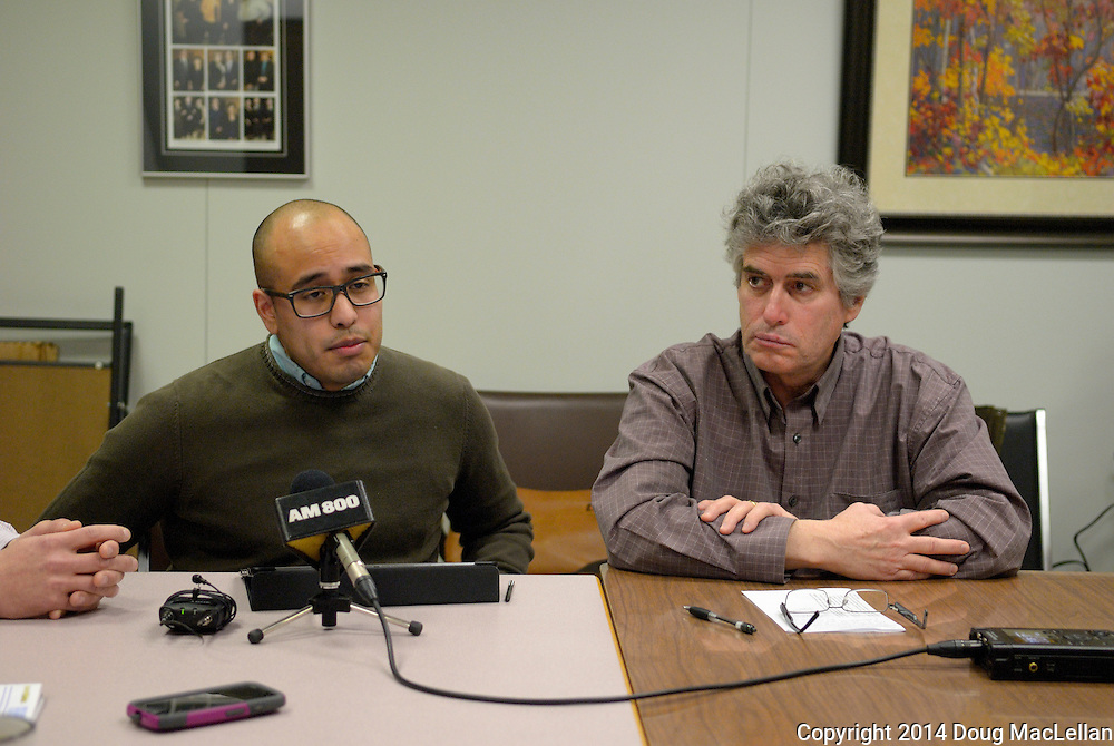 Hugo Vega of Windsor Y speaks and Paul Chislett of Windsor Workers' Action Centre listens during a press conference at Legal Assistance of Windsor about a comphrensive poverty reduction policy for Ontario.