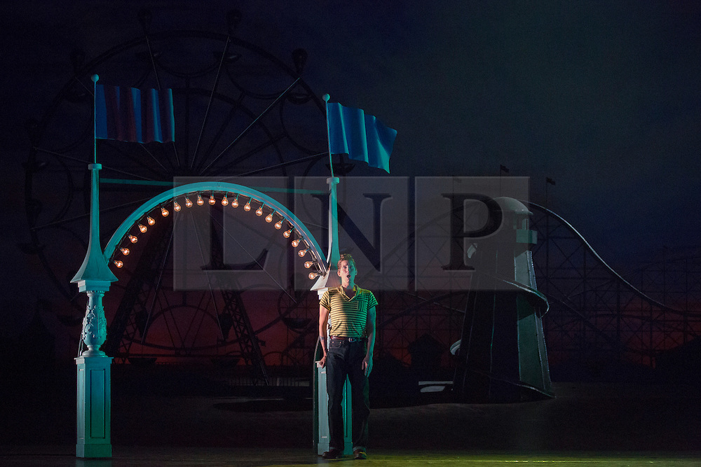 """© Licensed to London News Pictures. 14/05/2014. London, England. Randall Bills as Ferrando. Dress rehearsal of the Wolfgang Amadeus Mozart opera """"Così fan tutte"""" at the London Coliseum. A new ENO production of Mozart's dark comedy set in the world of a 1950's Coney Island funfair. With Kate Valentine as Fiordiligi, Christine Rice as Dorabella, Marcus Farnsworth as Guglielmo, Randall Bills as Ferrando, Mary Bevan as Despina and Roderick Williams as Don Alfonso. Directed by Phelim McDermott, Conductor: Ryan Wigglesworth. Co-produced by the English National Opera and the Metropolitan Opera, New York. In collaboration with Improbable. 12 performances from 16 May to 6 July 2014. Photo credit: Bettina Strenske/LNP"""
