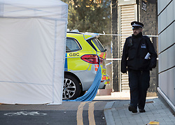 © Licensed to London News Pictures. 05/04/2018. London, UK. A police tent covers the murder scene as a blanket hangs from a police car (R) in Hackney where a 20 year old man was stabbed in Link Street. Police were approached by a man suffering from stab injuries at 8pm last night he was pronounced dead at 8. 24pm by officers. Photo credit: Peter Macdiarmid/LNP
