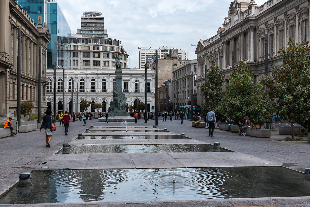 Santiage, Chile--April 6, 2018.  People are walking along wide open plaza with classical architecture on a street in Santiago, Chile. Editorial use only.