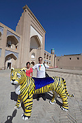 Uzbekistan, Khiva. Kultlimurodinok Medressa. Souvenir photographer with tiger for tourists. Heimo Aga with friends.