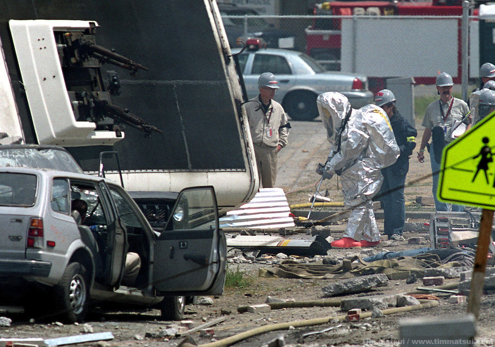 Seattle Fire Department personnel test for radiation as they respond to a mock terrorist attack south of downtown on Monday, May 12, 2003 in Seattle, Washington. Controllers set off an explosion shortly after noon which simulated the detonation of a radioactive dispersal device or 'dirty bomb.'