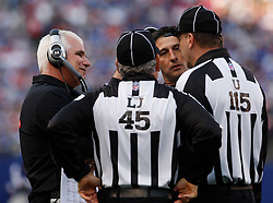 Nov 22, 2009; East Rutherford, NJ, USA; Atlanta Falcons head coach Mike Smith has a discussion with officials during the second half at Giants Stadium. The Giants won 34-31.  Mandatory Credit: Ed Mulholland