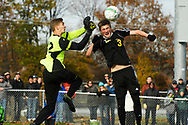Lake Region goalie Liam Kennedy (42) makes a save as Harwood's Will Lapointe (3) leaps to head the ball during the DII boys soccer championship game between Harwood and Lake Region at South Burlington High School on Saturday afternoon November 4, 2017 in South Burlington. (BRIAN JENKINS/for the FREE PRESS)