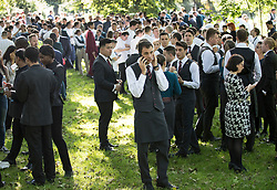 © Licensed to London News Pictures. 06/06/2018. London, UK. Evacuated staff from Mandarin Oriental hotel gather in Hyde Park during a fire. Fifteeen fire engines and 97 firefighters and officers have been called to a fire believed to be at the Mandarin Hotel in Kightsbridge. Photo credit: Peter Macdiarmid/LNP