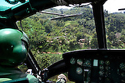 A view from a Thai amy BELL gunship circling over the troubled provinces and the jungle in the southern provinces. Thailand is struggling to keep up appearances as the land of smiles has to face up to its troubled south. Since 2004 more than 3500 people have been killed and 4000 wounded in a war we never hear about. In the early hours of January 4th 2004 more than 50 armed men stormed a army weapons depot in Narathiwat taking assault rifles, machine guns, rocket launchers, pistols, rocket-propelled grenades and other ammunition. Arsonists simultaneously attacked 20 schools and three police posts elsewhere in Narathiwat. The raid marked the start of the deadliest period of armed conflict in the century-long insurgency. Despite some 30,000 Thai troops being deployed in the region, the shootings, grenade attacks and car bombings happen almost daily, with 90 per cent of those killed being civilians. 26.09.07. Photo: Christopher Olssøn