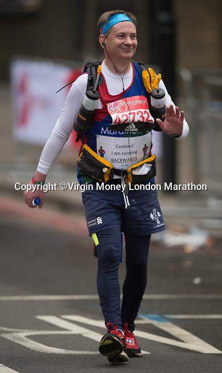 A runner competes in the marathon by running backwards. The Virgin Money London Marathon, 23rd April 2017.<br /> <br /> Photo: Joe Toth for Virgin Money London Marathon<br /> <br /> For further information: media@londonmarathonevents.co.uk