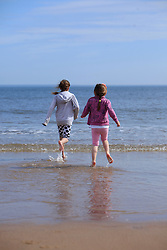 © Licensed to London News Pictures. 06/05/13 Kids go for a splash about in the sea as people start to head to the beach in Tynemouth North East England to enjoy the bank holiday weather as a warm front sits over the country Photo credit : John Millard/LNP