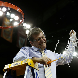 Apr 9, 2013; New Orleans, LA, USA; Connecticut Huskies head coach Geno Auriemma celebrates after cutting the net after the championship game in the 2013 NCAA womens Final Four against the Louisville Cardinals at the New Orleans Arena. Connecticut defeated Louisville 93-60. Mandatory Credit: Derick E. Hingle-USA TODAY Sports