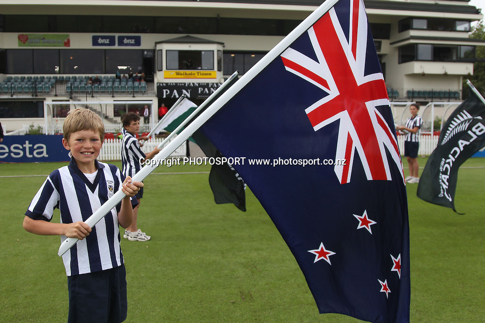 Flag Bearers. New Zealand Black Caps v Pakistan, Match 2. Twenty 20 Cricket match at Seddon Park, Hamilton, New Zealand. Tuesday 28 December 2010. Photo: Andrew Cornaga/photosport.co.nz