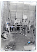 eroding glass plate with male group stand by workbench