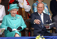 WINDSOR, UK:The Queen and Duke of Edinburgh watch the Windsor Jubilee Procession pass through the town centre on the 3rd June 2002.<br /> PHOTOGRAPH BY JAMES WHATLING