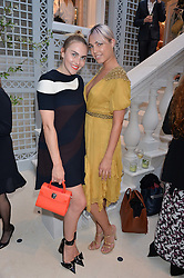 Left to right, BECKY TONG and AMBER LE BON at a cocktail party to mark the opening of the House of Dior, the United Kingdom's largest and premier Dior boutique at 160-162 New Bond street, London on 8th June 2016.