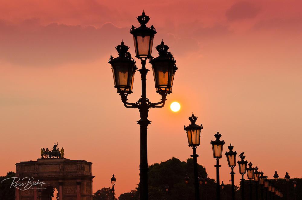 Lamp posts at sunset, Louvre Museum, Paris, France