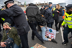 © Licensed to London News Pictures. 15/03/2019. London, UK. Police make two arrests following an 'after party' held on Westminster Bridge, which blocked traffic for several hours.  School children across the UK took part in an international day of action protesting inaction over climate change. An 'after party' was held on Westminster Bridge, blocking traffic for several hours.  Photo credit: Guilhem Baker/LNP